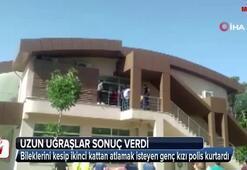 Polis binadan atlamak isteyen genç kızı böyle kurtardı