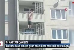 Balkona hava almaya çıkan adam önce asılı kaldı sonra düştü