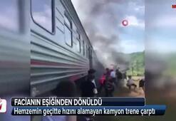 Hemzemin geçitte hızını alamayan kamyon trene çarptı
