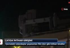 Eşiyle tartıştı çatıda çıkıp intihara kalkıştı...