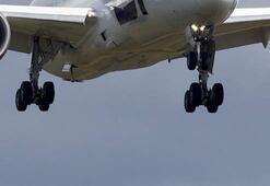 Ülke şokta Uçağın iniş takımından erkek cesedi evin bahçesine düştü