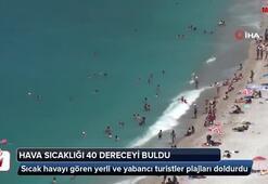 Sıcak havayı gören yerli ve yabancı turistler plajları doldurdu