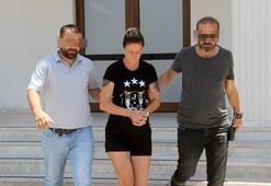 Suç makinesi kadın plajda güneşlenirken yakalandı