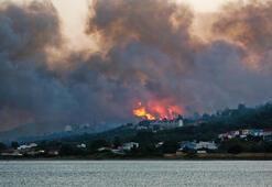 Sisamda orman yangını durdurulamıyor Turist plajlardan tahliye edildi