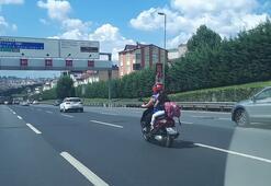 E-5'te korkutan görüntü...Kadın motosiklet sürücüsü arkasındaki çocuğu iple kendisine bağladı