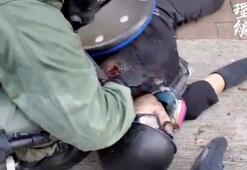 Hong Kongda polisin vurduğu genç kadın, saldırı ve isyanla suçlandı
