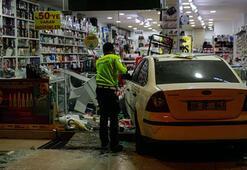 Başkentte kaza yapan otomobil iş yerine girdi