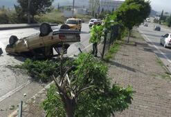 Otomobiliyle kamyoneti sollamak isterken takla attı
