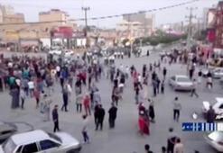 İrandaki gösterilerde bir polis öldürüldü