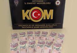 Polisi görünce paraları atıp kaçmaya çalıştı