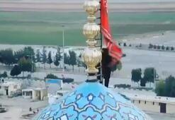 İranda bir camiinin kubbesine intikamı temsil eden kırmızı bayrak çekildi