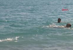 Antalyada tatilciler güneşli havanın keyfini çıkardı
