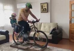 Rizeli baba sahilde gezmek isteyen kızı için bisiklet keyfini eve taşıdı