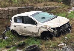 Otomobil takla attı 4 kişi yara almadan kurtuldu