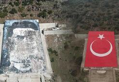 Terörist başı Öcalan portresi yerine dev Türk bayrağı