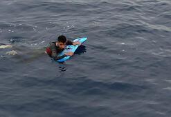 Bodrumdan Yunanistana sörf tahtasıyla geçmeye çalışan sığınmacı yakalandı