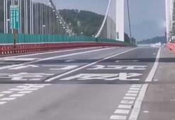 Çindeki Hummen Köprüsü şiddetli rüzgarla böyle sallandı