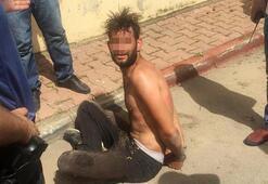 Nefes nefese yakalanan şüpheliyi polis suyla serinletti