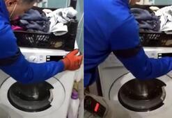 Çamaşır makinesinin gizli bölmesinden 7 bin paket kaçak sigara çıktı