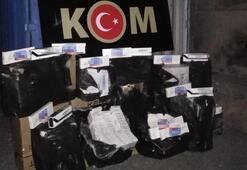 Çamaşır makinesini çekince... Gizli bölmeden 7 bin paket kaçak sigara çıktı