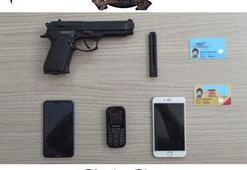Sahte polis kimliği ve silah ile yağma
