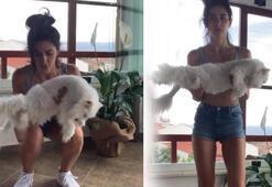 Güzel oyuncu Nesrin Cavadzade kedisiyle spor yaptı