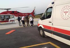 Bursada kazada yaralanan çiftçi, ambulans helikopterle hastaneye ulaştırıldı