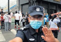Pekin'de ikinci dalga paniği 11 mahalle karantina altında
