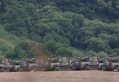 Son dakika: Kuzey Kore havaya uçurdu Tanklar sıra sıra dizildi...