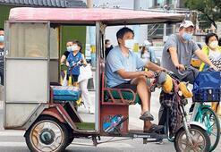 Pekin yeniden karantinada Okullar kapatıldı, uçuşlar iptal edildi