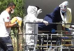 Corona tedavisi gören kadın çocuklarıyla yanan binada mahsur kaldı