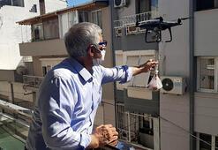 İzmirde sosyal mesafeye dikkat çekmek için kurban etini dronla gönderdi