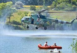 Ukraynada askeri helikopter tatilcilerin arasında tatbikat yaptı