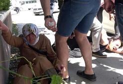 Cadde ortasında annesini döven gence, tekme tokat dayak