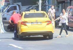 Maskesiz yolcuya ceza yazan polise taksiciden tepki