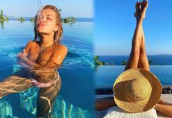 Rita Ora'dan havuzda üstsüz paylaşım
