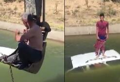 Aracıyla sulama kanalına düştü Yardımına kepçe ile muhtar yetişti