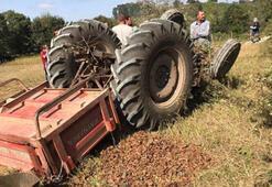 Devrilen traktörün altında kaldı, çevredekiler kurtardı