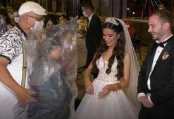 Düğünde görülmemiş önlem Yorgan poşetini kafasına geçirip sarıldı