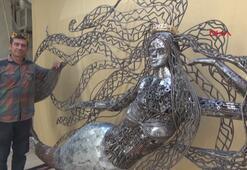Hurda parçaları ile deniz kızı heykeli yaptı