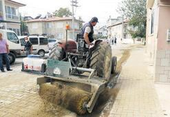 Kum süpürgesiyle daha temiz sokaklar