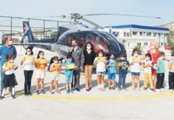 Oğuzhan Özkaya'dan miniklere helikopterle tur