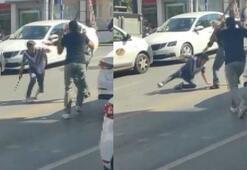 Trafikte sopalı kavga kameraya yansıdı