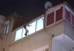 Cezaevi firarisi gözaltına alınmak isteyince pencereye çıkıp intihara kalkıştı