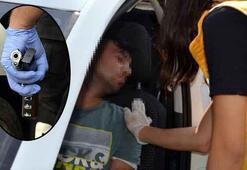 Çalışır haldeki otomobilde elinde tabancayla uyudu