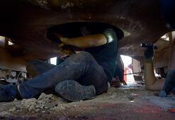 İş makinesinin operatör kabinine gizlenmiş 51 kilo 366 gram esrarı 'Uzi' buldu