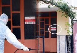 Kovid-19 hastası kişilerin yaşadığı binalara uyarı levhası asılıyor