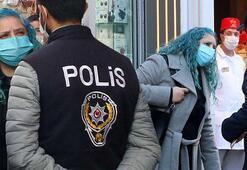 Taksimde maske takmadığı için ceza yazılmak istenen kadın polise zor anlar yaşattı