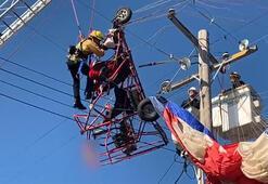 Paraşütü elektrik tellerine dolaştı