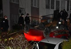 İzmirde takla atan araç sokaktaki arabaların üzerine uçtu